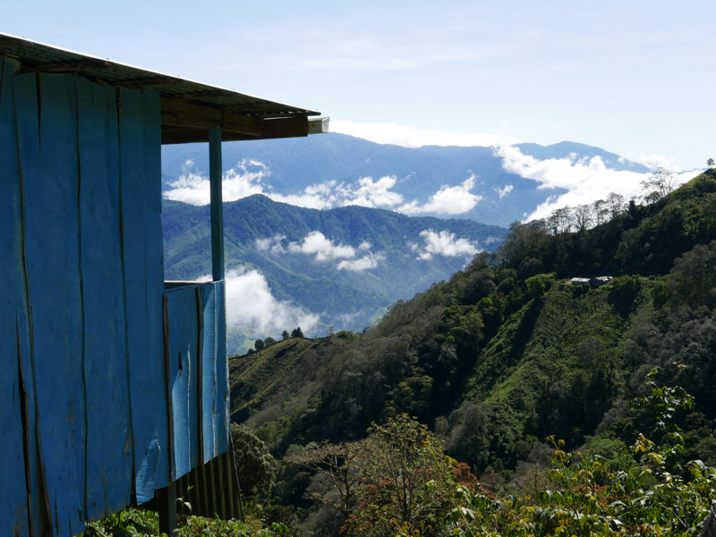 A blue house perched on the side of a mountain pass in Costa Rica Behind the Scenes of Order to Kill